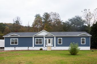 The THE KENNESAW Exterior. This Manufactured Mobile Home features 4 bedrooms and 2 baths.
