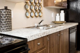 The EUPHORIA Kitchen. This Manufactured Mobile Home features 3 bedrooms and 2 baths.