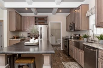 The THE KENNESAW Kitchen. This Manufactured Mobile Home features 4 bedrooms and 2 baths.