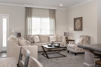 The THE KENNESAW Living Room. This Manufactured Mobile Home features 4 bedrooms and 2 baths.